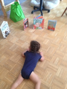 Cate crawling to the books she will read today.